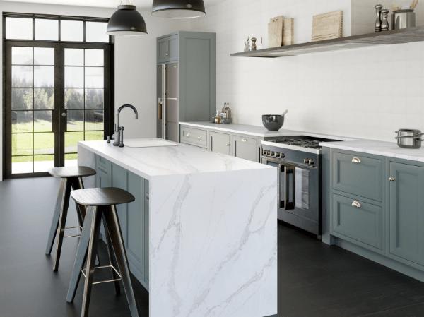 sage green kitchen with marble worktops