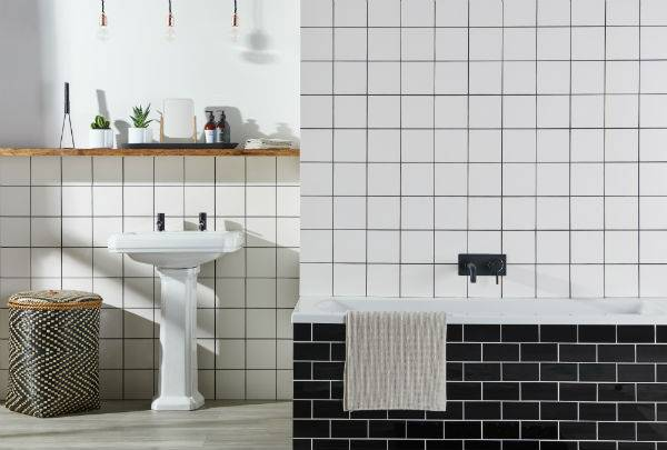 white bathroom tiles with black grout